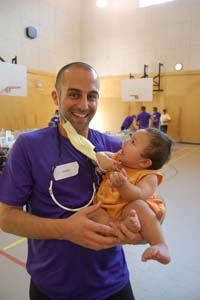 Dustin George (DMD 2011 candidate) with a young resident of Kuper Island.