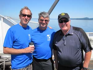 Garry Sutton DMD 1972 (pictured on the left) and Doug Nielsen DMD 1972 (centre) enjoy a moment on the ferry to Kuper Island with friend, Bob Blacker from the Rotary Club.