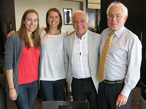 Then fourth-year dental students Melissa Milligan (L) and Kathryn Hunter are seen with Dr. Dr. Arjang Nowtash, President of Sinclair Dental and Dr. Bill Brymer (R), Clinical Assistant Professor and Clinical Group Advisor, UBC Dentistry.