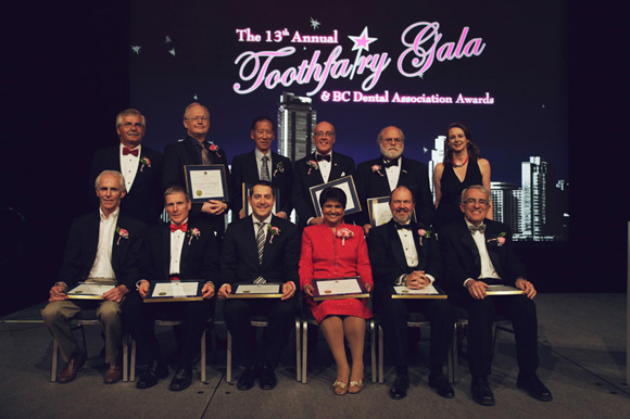 Assembled together, all the BC Dental Association award winners with BC Dental Association representatives at the 13th Annual Toothfairy Gala on March 9, 2013 at the Vancouver Convention Centre. Top row from left to right: Drs. Richard Wilczek, President of the BC dental Association; Robert McDougall; Ken Lee; Jim Gray; Charles Shuler and Ms. Jocelyn Johnston, Executive Director, BC Dental Association. Bottom row from left to right: Drs. Jim Guild, Ken Stones, Christopher Zed, Saida Rasul, Robert Priddy and Doug Johnston.