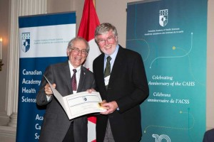 Dr. Michael MacEntee (R), professor emeritus of Prosthodontics and Dental Geriatrics, with Dr. John Cairns, CAHS president and former dean, UBC Faculty of Medicine, at the Canadian Academy of Health Sciences Fellowship induction ceremony, September 17, 2015.