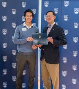 John Sharp, UBC dental student and Academic All-Canadian with UBC President Santa Ono.